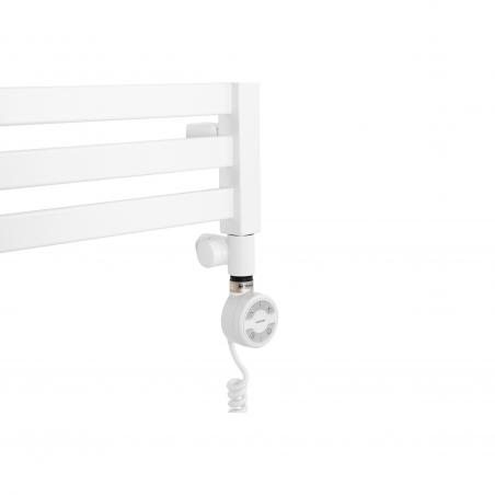 Grzałka Terma Moa biała, zamontowana poprzez biały trójnik powrotny z zestawu Integra do grzejnika łazienkowego Terma Moon w kolorze białym.
